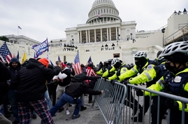 Trump supporters try to break through a police barrier, Wednesday, Jan. 6, 2021, at the Capitol in Washington. As Congress…