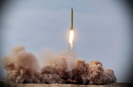 In this photo released on Saturday, Jan. 16, 2021, by the Iranian Revolutionary Guard, a missile is launched in a drill in Iran…