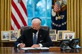 President Joe Biden signs an Executive Order reversing the Trump era ban on transgender individuals serving in military, in the…