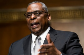 Secretary of Defense nominee Lloyd Austin, a recently retired Army general, speaks during his conformation hearing before the…