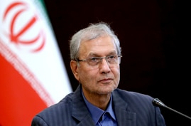 "In this July 7, 2019, photo, Iran's government spokesman Ali Rabiei speaks in a press briefing in Tehran, Iran. Iran will ""take…"