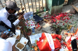 People mourn at the site where a young man died during a protest against the military coup, in Yangon, Myanmar, Sunday, Feb. 28…