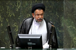 Iranian Intelligence Minister Mahmoud Alavi answers questions from lawmakers in an open session of parliament in Tehran, Iran,…