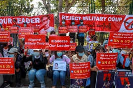 Demonstrators display placards supporting UN and U.S. actions against Myanmar military during a protest against the military…