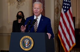 Vice President Kamala Harris, left, looks on as President Joe Biden delivers a speech on foreign policy, at the State…