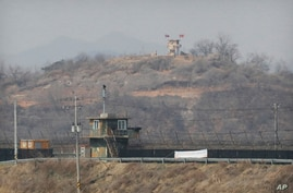 Military guard posts of North Korea, rear, and South Korea, bottom, are seen in Paju, at the border with North Korea, South…