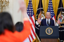 President Joe Biden speaks during a news conference in the East Room of the White House, Thursday, March 25, 2021, in…