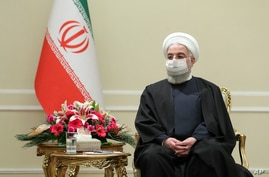In this photo released by the official website of the office of the Iranian Presidency, President Hassan Rouhani meets with…