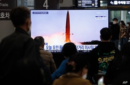 People watch a TV showing a file image of North Korea's missile launch during a news program at the Suseo Railway Station in…