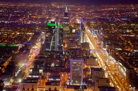 FILE - In this March 9, 2018, file photo, an aerial view of Riyadh city is seen from Mamlaka tower, a 99-story skyscraper, in…