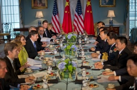 Deputy Sec. of State Antony J. Blinken, left, with China's State Councilor Yang Jiechi, right, and members of the US and…