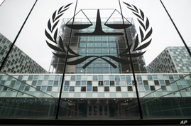FILE- In this Nov. 7, 2019 file photo, the International Criminal Court, or ICC, is seen in The Hague, Netherlands. The…