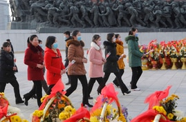 Pyongyang citizens visit the Mansu Hill to pay tribute to the bronze statues of their late leaders Kim Il Sung and Kim Jong Il…
