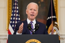 President Joe Biden speaks about the March jobs report in the State Dining Room of the White House, Friday, April 2, 2021, in…