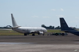 The U.S. Navy P-8 Poseidon aircraft prepare to take off at Ngurah Rai Military Air Base in Bali, Indonesia on Saturday, April…
