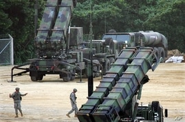 FILE - In this Feb. 9, 2007 file, Patriot missiles PAC-3 launchers are seen at the Kadena U.S. Air Base in Okinawa, southern…