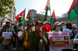 Demonstrators display ethnic Kachin flags during a protest in Yangon, Myanmar, Wednesday, Feb. 10, 2021. Protesters continued…