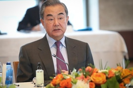 China's Foreign Minister Wang Yi talks during a meeting with Turkey's Foreign Minister Mevlut Cavusoglu, in Ankara, Turkey,…