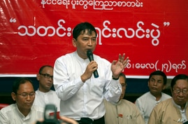 Min Ko Naing, a leader of Myanmar Prominent 88 Generation Students Group, talks to journalists during a press conference at…