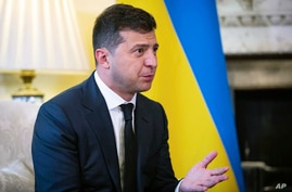 Ukraine President Volodymyr Zelensky, gestures as he talks to Britian's Prime Minister Boris Johnson,  during a meeting, in…