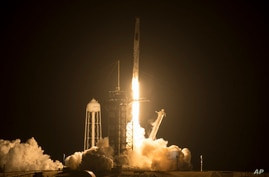 A SpaceX Falcon 9 rocket carrying the company's Crew Dragon spacecraft is launched on NASA's SpaceX Crew-2 mission to the…