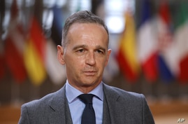German Foreign Minister Heiko Maas speaks with the media as he arrives for a meeting of EU foreign ministers at the European…