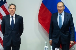 U.S. Secretary of State Antony Blinken, left, poses with Russian Foreign Minister Sergey Lavrov, right, before a meeting at the…
