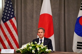 United States' Secretary of State Antony Blinken participates in a trilateral meeting with the foreign ministers of Japan and…
