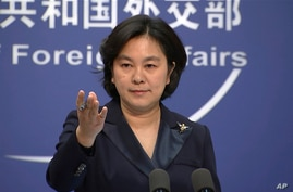 FILE - In this Jan. 20, 2021, file photo, Chinese Foreign Ministry spokesperson Hua Chunying speaks during the daily press…