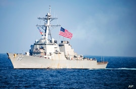 In this March 22, 2017, photo provided by U.S. Navy, U.S. Navy destroyer USS Stethem transits waters east of the Korean…