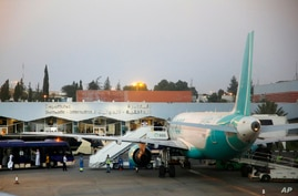 FILE - In this Aug. 22, 2019 file photo, passengers leave the arrival terminal of Abha airport, south of Saudi Arabia.  Saudi…