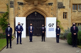 G7 health ministers pose for a photo before they continue their meeting at Oxford University ahead of the G7 leaders' summit,…
