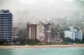 Workers search in the rubble at the Champlain Towers South Condo, Saturday, June 26, 2021, in Surfside, Fla. One hundred fifty…