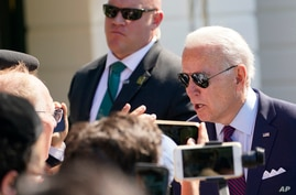President Joe Biden talks to reporters before boarding Marine One on the South Lawn of the White House in Washington, Tuesday,…