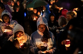 People hold candles during a vigil for the centennial commemorations of the Tulsa Race Massacre in the historic Greenwood…
