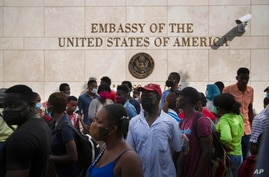Haitians gather outside the U.S. Embassy in Port-au-Prince, Haiti, Friday, July 9, 2021. A large crowd gathered outside the…