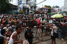 A crowd waits outside Insein Prison in Yangon, Myanmar Wednesday, June 30, 2021.  Myanmar's government began releasing about 2…