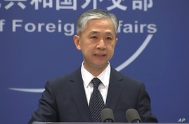 China's Foreign Ministry spokesperson Wang Wenbin speaks during the daily briefing in Beijing on Friday, June 11, 2021. China…