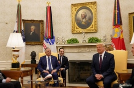 U.S. President Donald Trump meets with Iraq's Prime Minister Mustafa al-Kadhimi in the Oval Office at the White House in Washington