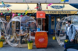 FILE PHOTO: Bubble tents are set up outside Cafe Du Soliel following the outbreak of the coronavirus disease (COVID-19) in the Manhattan borough of New York City