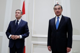 China's State Councillor Wang Yi meets Canada's FM Francois-Philippe Champagne in Rome