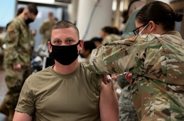 A U.S. Air Force soldier gets a coronavirus disease (COVID-19) vaccine at Osan Air Base in Pyeongtaek