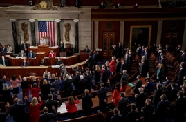 Members of the House of Representatives take their oath of office during the first session of the 117th Congress in Washington