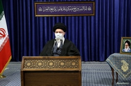 Iran's Supreme Leader Ayatollah Ali Khamenei wears a mask during a virtual speech, in Tehran