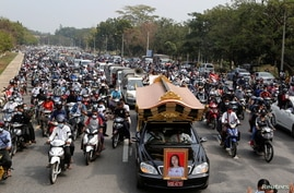 Hundreds attend the funeral of a young woman protester