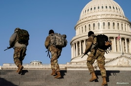 Security personnel patrol at the U.S. Capitol in Washington