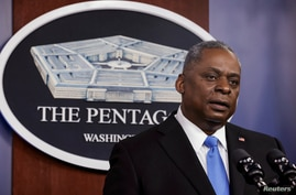 FILE PHOTO: U.S. Defense Secretary Lloyd Austin speaks during President Biden's visit at the Pentagon in Arlington, Virginia