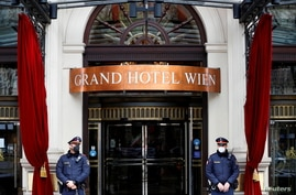 FILE PHOTO: Police stand outside a hotel where a meeting of the Joint Commission of the Joint Comprehensive Plan of Action (JCPOA), or Iran nuclear deal, is held in Vienna, Austria,