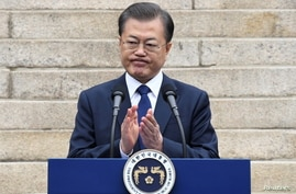FILE PHOTO: South Korea's President Moon Jae-in applauds during a ceremony marking the 101st anniversary of the March 1st Independence Movement Day in Seoul,