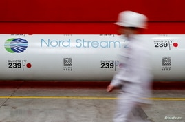 FILE PHOTO: The logo of the Nord Stream 2 gas pipeline project is seen on a pipe at the Chelyabinsk pipe rolling plant in Chelyabinsk, Russia
